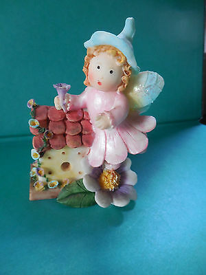 SWEET  FAIRY -  GLITTER  WINGS  - STANDING  with  LITTLE  COTTAGE .