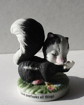 "Vintage Ceramic-Porcelain Skunk Figurine Holding Nose ""Love Overlooks All Things"