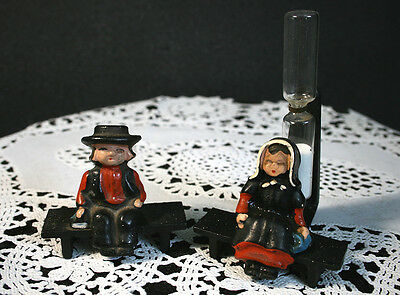 Antique Amish Cast Iron Man & Woman on Bench Woman has an Hour Glass Behind Her