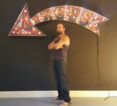 Large hand crafted Circus Arrow.