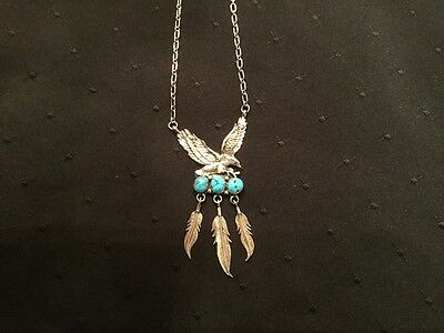 Sterling Silver landing eagle necklace with turquoise and feathers