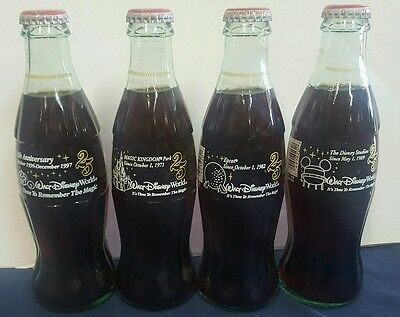 4 Disney commemorative coke coca cola bottle set