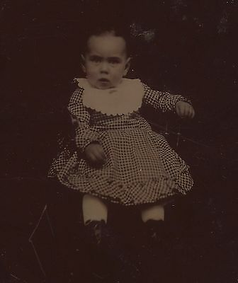 OLD VINTAGE ANTIQUE TINTYPE PHOTO of CUTE LITTLE BABY IN CHECKERED DRESS
