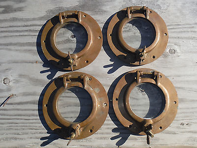 set of 4 matching brass portholes