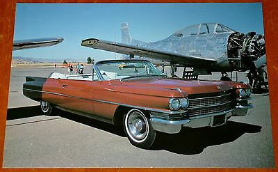 1980s PHOTO CLASSIC 1963 CADILLAC DEVILLE CONVERTIBLE WITH AMERICAN WAR PLANE