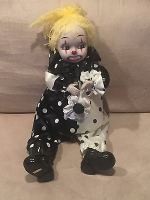 Clown Doll Figurine Music Wind Up with Porcelain Face Hands and Feet.
