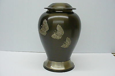 Dark grey funeral cremation urn human ashes with flying silver butterflies Urne