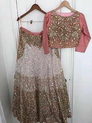 Indian Bridal Pink and Gold Wedding Reception Lehenga