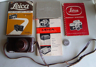 Vintage Leica 35mm camera accessories: Case, Lens Cap, Original books