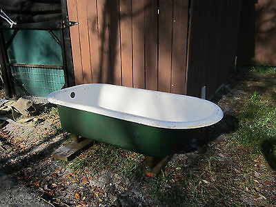 "old 1941 cast iron bath tub 60"" long X 30"" wide"