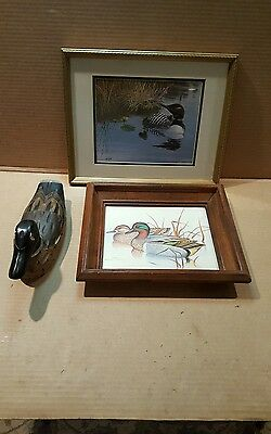 2-duck pictures and a wooden duck
