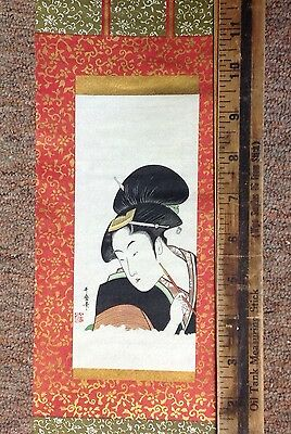 Antique Japanese Print: Woman holding a pipe by Utamaro