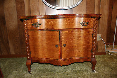 Antique cabinet with wooden roping