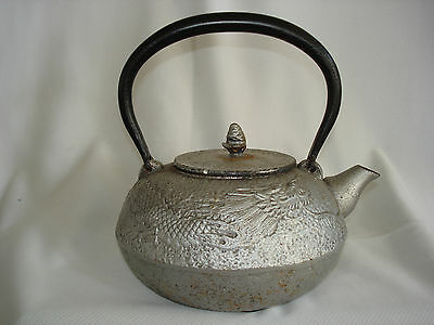 Antique Chinese cast iron tea pot with nice embossed dragon