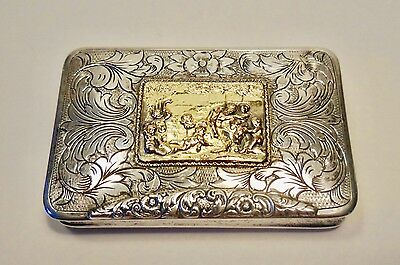 "1928 ENGRAVED 800 SILVER SNUFF/PILL BOX w/PUTTI REPOUSEE GOLDEN SCENE-3""x2""x1/2"""