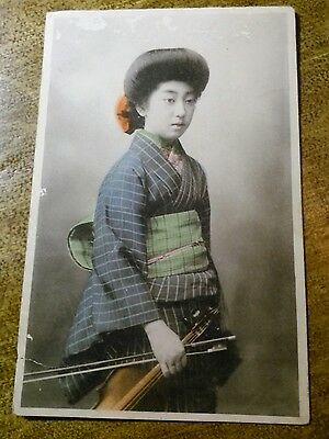 Japan, Geisha Girl Dressed in Kimono with violin (1915-30)
