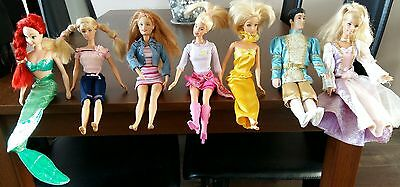 7 Barbie Dolls