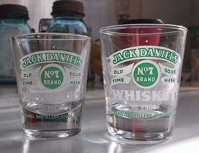 a pair of JACK DANIEL'S OLD TIME NO7 SOUR MASH WHISKEY 90 proof shot glasses