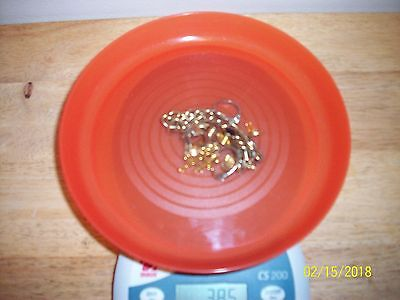 38.5 grams of 18K gold scrap or use marked and/or tested guaranteed .99 start #2