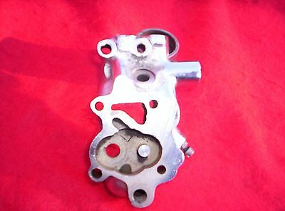Chrome Panhead oil pump body, great condition.