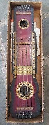 Ukelin Hawaiian Musical instrument,by the Mfg's Advertising Co.USA w/books
