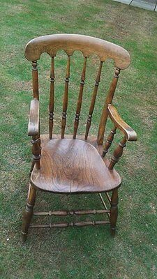 antique large spindle back chair with arms