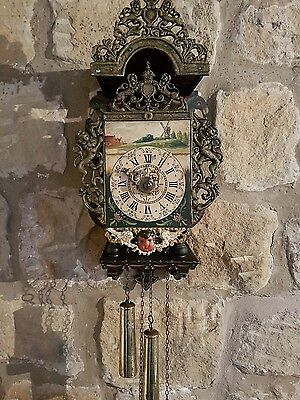A quality antique dutch wall clock all original complete with tapered weights