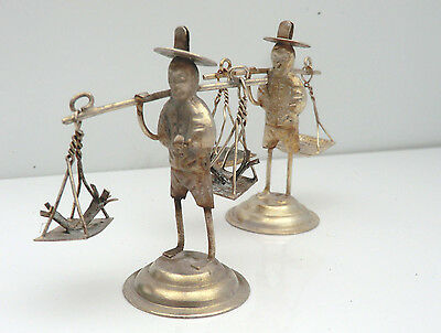 Pair of Small White Metal Chinese Figurines Carrying Baskets
