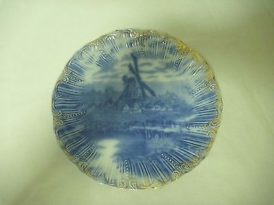 Antique Blue flow WINDMILL plate with gold to the edge.