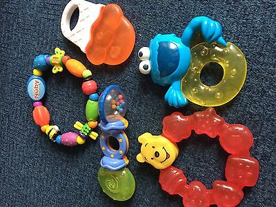 Bundle Of Teethers Including Winnie The Pooh And Cookie Monster