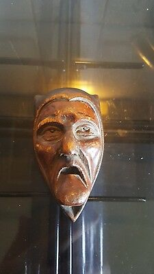 late 19th century carved mask of a grotesque