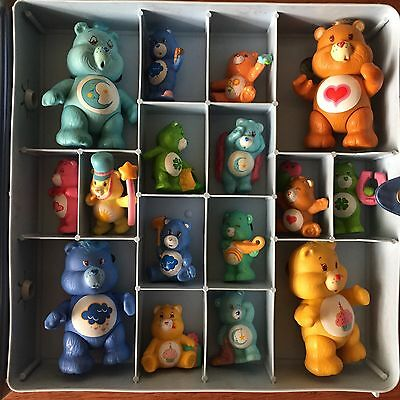 Lot of 58 Vintage Kenner Care Bears Figures with 4 Cases