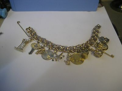 VINTAGE 1960's STYLE 12 K GOLD FILLED CHARM BRACELET/WITH 12 GREAT CHARMS/6 1/2""