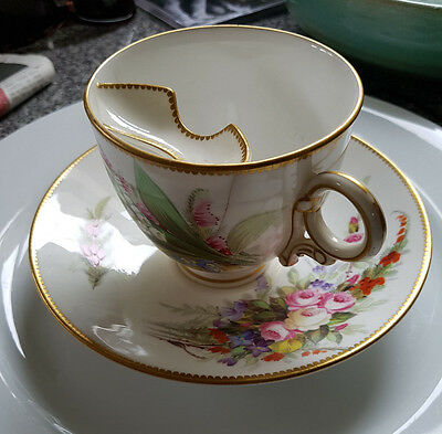 antique tea cup & saucer with moustache protecter