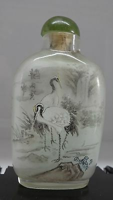A Chinese glass snuff bottle, painted to the inside with storks and horse