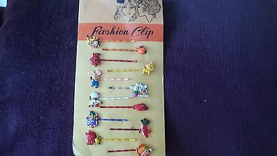 VINTAGE ANIMAL THEME HAIRCLIPS 1970s.12 IN TOTAL ON ORIGINAL CARD.