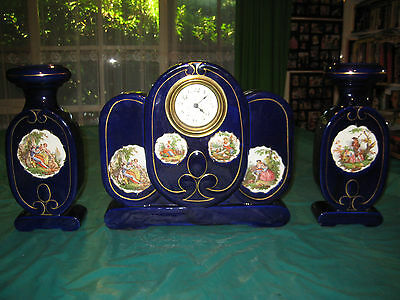 Antique clock and matching vases