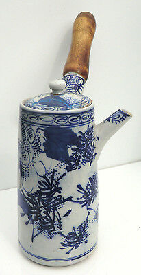 Early 20th century Japanese Arita blue & white chocolate pot, decorated flowers
