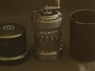 CURTA type I calculator with can, serial number 68 335 (composite number).