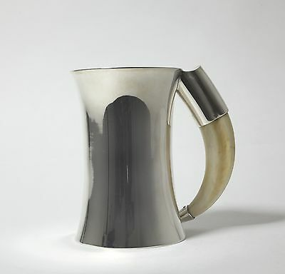 Silver mug with the handle of the fang. Sweden, Workshop C. G. Hallberg, 1916