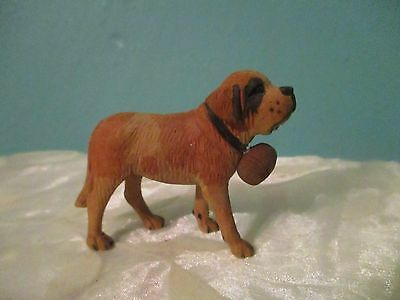 Old vintage hand carved wooden St. Bernard dog