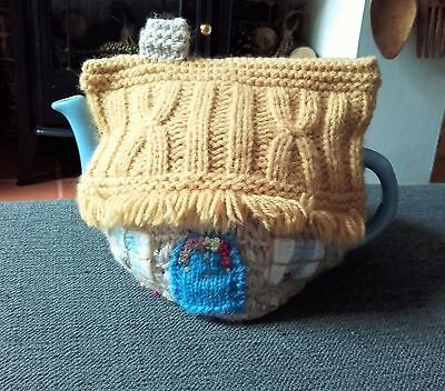 Teapot and country cottage,hand knitted tea cosie,good condition,used.