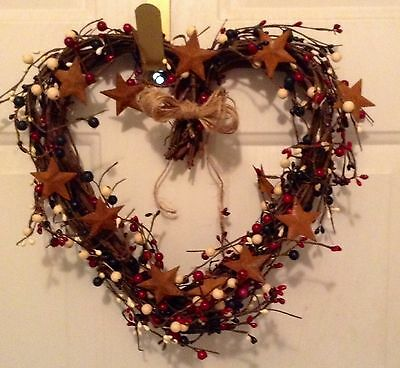 Heart shaped grapevine wreath /rustic red white blue berries yellow stars / bow