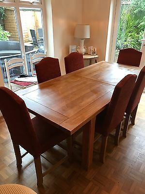 Solid Oak Extending table and 6 chairs.