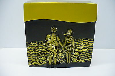 Double urn high-end brass cremation human ashes gold and black couple walking