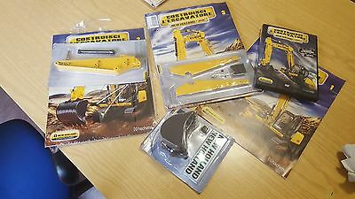 Hachette New Holland escavatore ec 215 varie uscite
