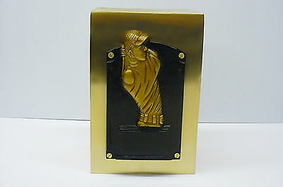Funeral cremation urn human ashes gold brass color with a golfer in relief
