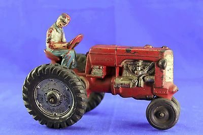 Unusual Auburn Rubber Large Farmer On Red Tractor