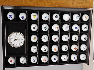 NFL logo golf balls in display case with clock