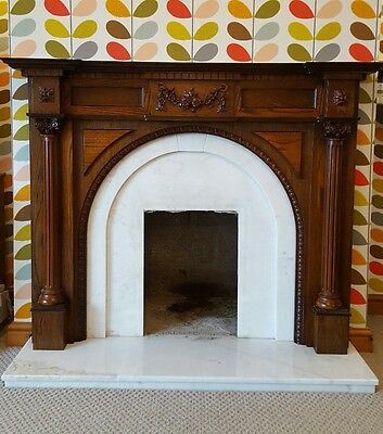 marble fireplace with wood surround